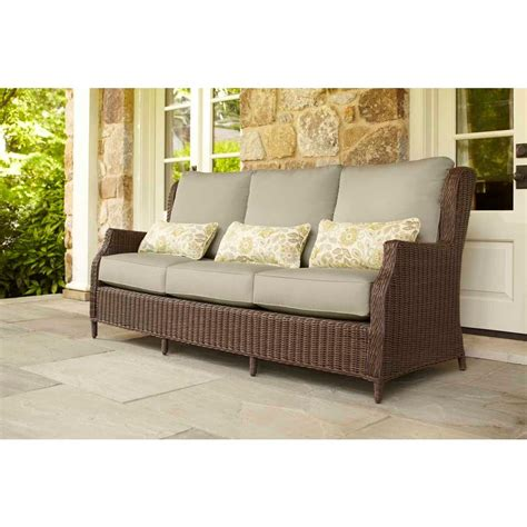 brown vineyard patio sofa with meadow cushions and