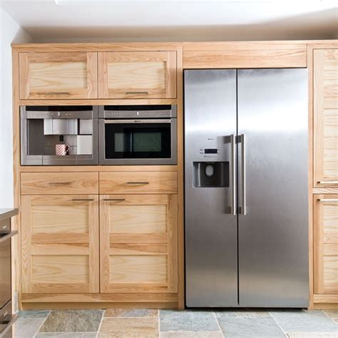 kitchen integrated appliances integrated appliances step inside a coastal kitchen filled with natural materials
