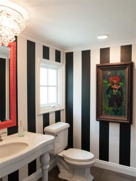 black  white striped powder room  colorful accents