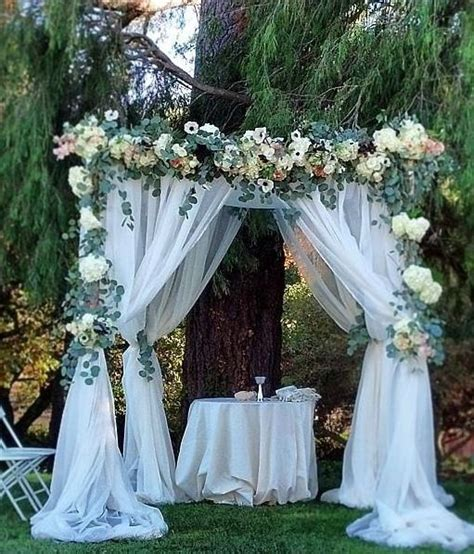 green and white floral outdoor wedding ceremony wedding