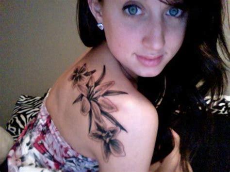 black gladiolus larkspur flower tattoo  shoulder