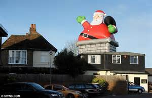 huge inflatable santa  strapped  pub roof  high
