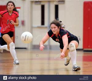 A player digs out a spike during the girls High School ...