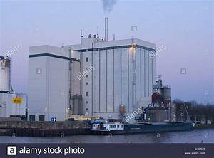 Cargo ship in front of an industrial building ready to be ...