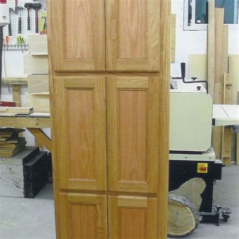 handmade 6 door linen closet by ziegler woodwork and