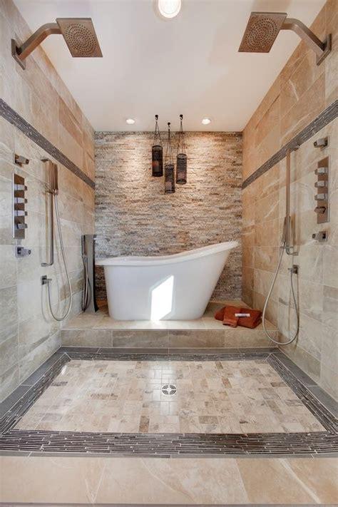 master bathroom  limestone tile floors dual shower