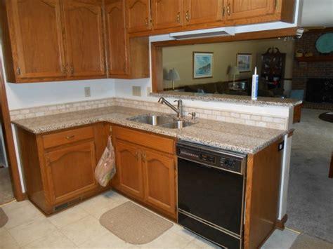 creme caramel granite traditional kitchen