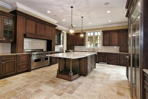 love the stone floor color and pattern. Dark Kitchen