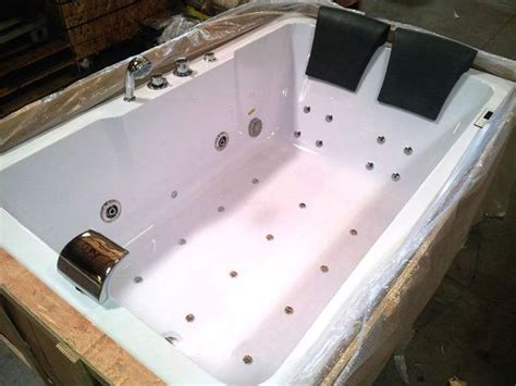 person indoor whirlpool jetted hot tub spa hydrotherapy