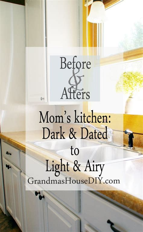 painting kitchen cabinets   moms dark kitchen