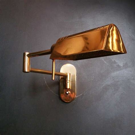 swing arm wall lamp nylux