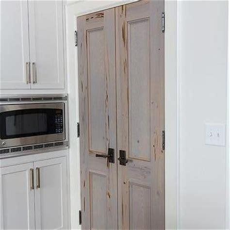bi fold bathroom doors  brass door knobs