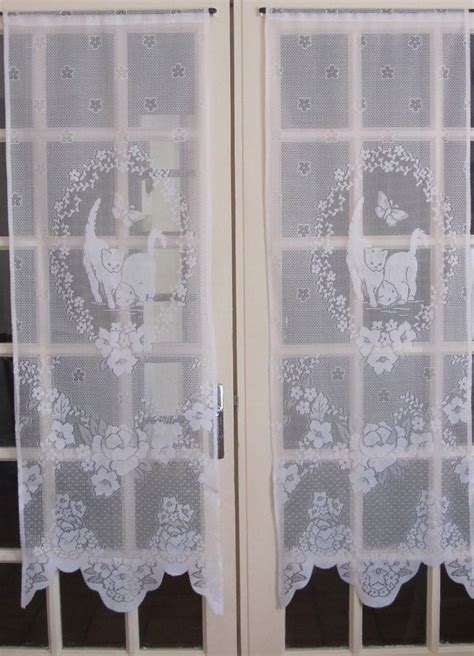 white door curtains white lace curtains cats