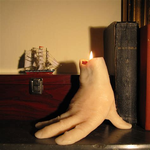 hand candle bleeds   burns  green head