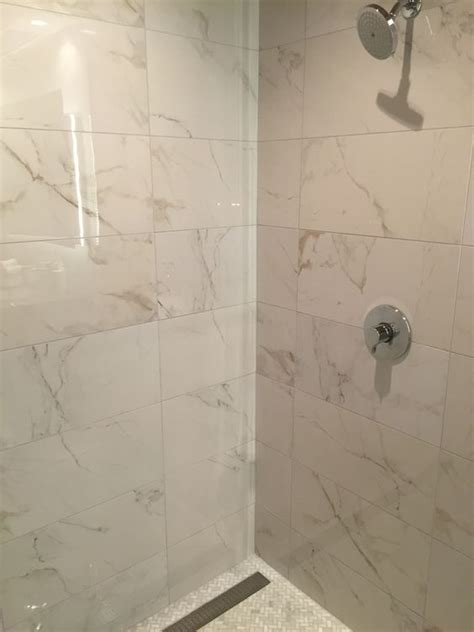 pinned  show porcelain calacatta tile  shower