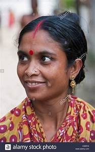 A Hindu woman with a red dot, or bindi, on her forehead at ...