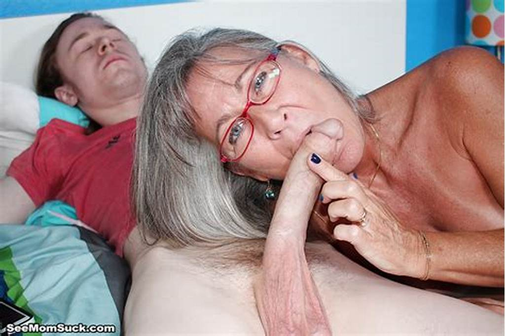 #Grey #Haired #Mature #Woman #Gives #A #Younger #Man #A #Tugjob #He