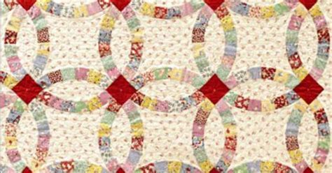 wedding ring quilt using quiltsmart applique rather than traditional curved piecing