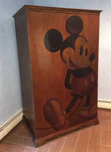While recently photographing items in the home décor showroom at disney theme park merchandise headquarters, some awesome new coffee mugs caught my eye. AWSOME Mickey Mouse Wooden Entertainment Center / TV Armoire & Coffee Table #Disney #Traditional ...