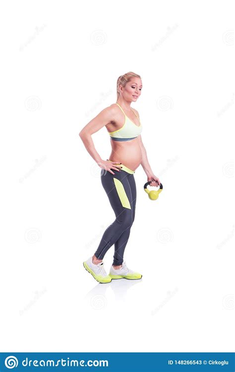 pregnant doing happy kettlebell exercise lifestyle fitness