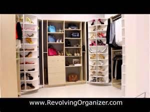 closet organizer in a walk in closet revolving shoe rack