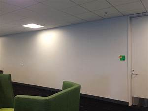 Worker uses post it notes to turn boring office