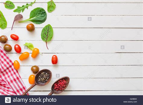cooking background vegetables spices and cooking utensils on white wooden