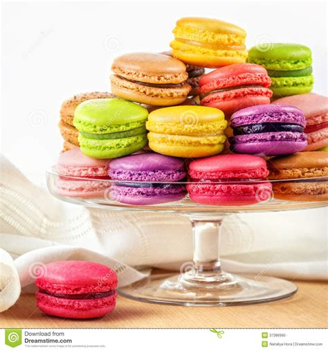 cuisine kawaii colorful macarons in a glass cake stand stock image