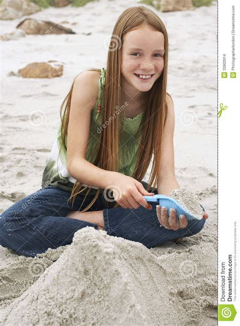 girl making sand castle  beach stock images