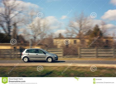Car Speeding Down The Road Royalty Free Stock Images