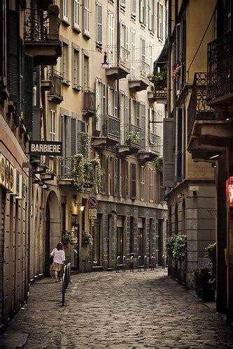 narrow street  milan italy photo  sunsurfer