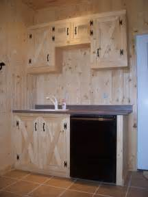 tack room features custom pine cabinets  tile floor