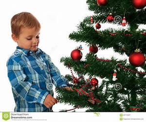 Kid Decorating Christmas Tree Stock Image - Image: 22113321