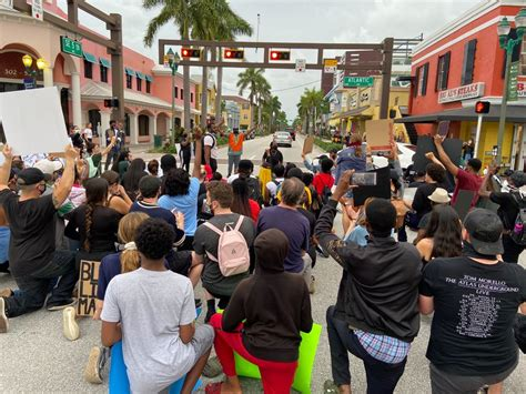 Protesters march in downtown Delray Beach   WPEC