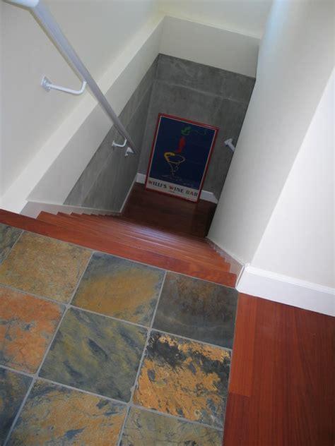 slate landing wood stairs custom railing  basement wine cellar