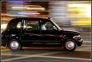 Black cab in London. | A panning shot on a famous black ...