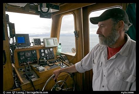 picturephoto captain steering boat  navigation