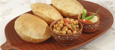 Chole bhature is a famous indian dish. Chole Bhature   Traditional Street Food From Delhi, India ...