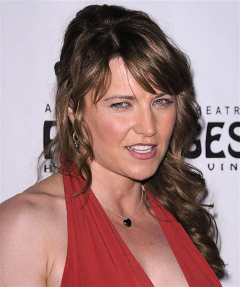lucy lawless casual long curly   hairstyle  side