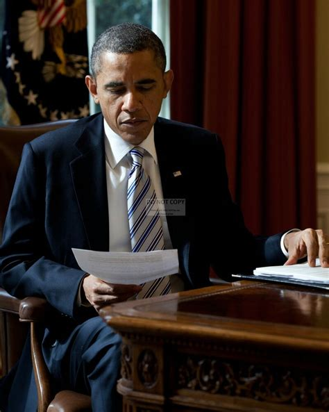 obama in the office president barack obama reads a document in the oval office