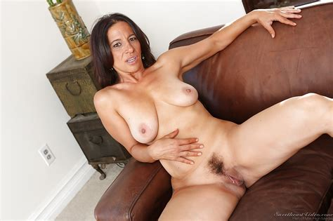 Mature Brunette Melissa Monet Stripping And Spreading Her