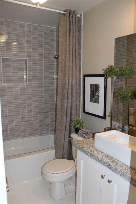 bathroom entranching small bathroom with bathtub and
