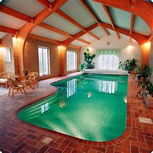 20 niftiest indoor swimming pool designs for Indoor swimming pool design ideas