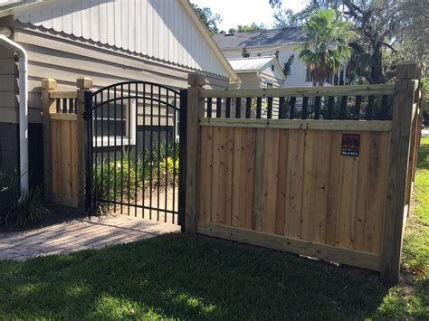 privacy gates and fences custom wood privacy fence and scalloped aluminum gate designed and installed by mossy oak fence