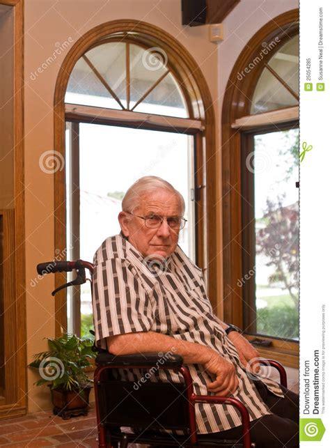 sad  man  wheelchair royalty  stock photo image