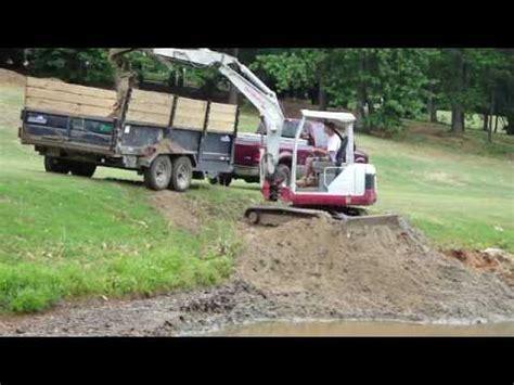 mini excavator loading dump trailer youtube