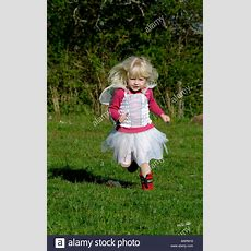 A 3 Year Old Girl Running In The Garden Whilst Dressed Up In Her Best Stock Photo 23855588 Alamy