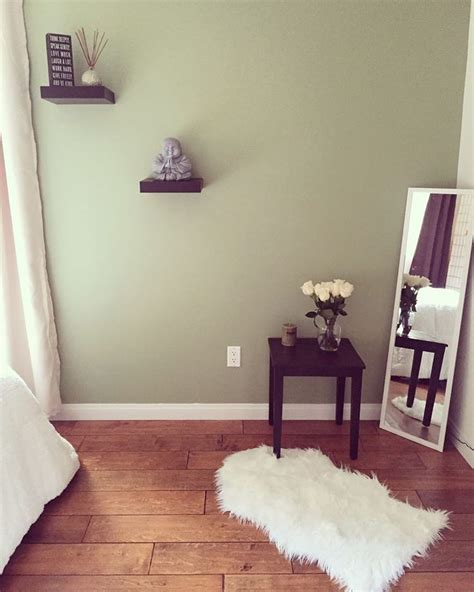 zen style bedroom sage green wall paint buddha accessory