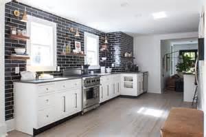 black backsplash kitchen white kitchen with gray quartz countertops and glossy black backsplash tiles contemporary