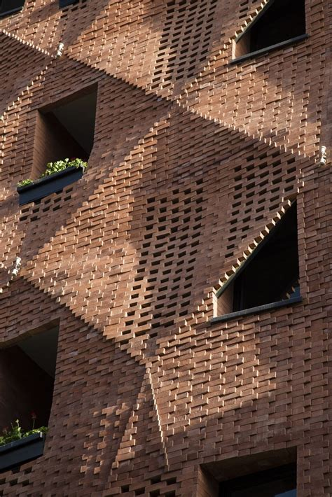 wood block coffee table an origami like tri dimensional brick façade inspirationist